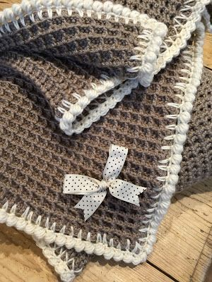 The waffle stitch is a gloriously textured stitch that makes a great baby blanket your little one will love