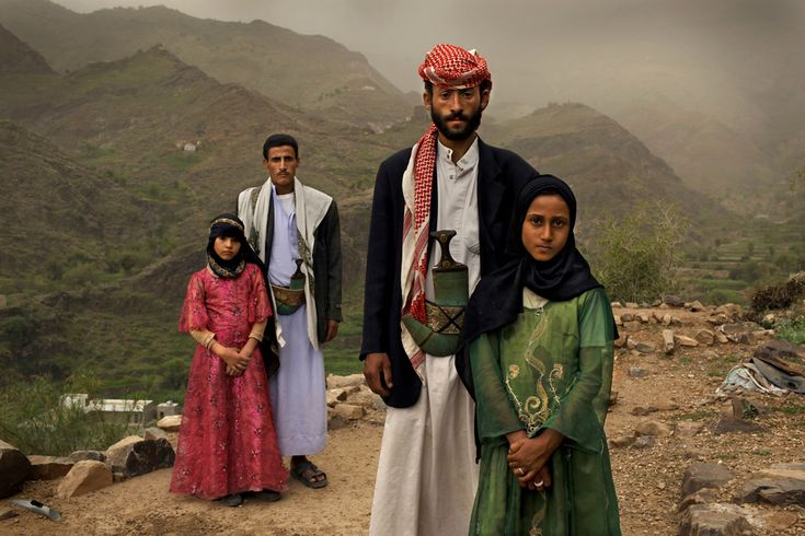1st Prize Contemporary Issues Stories: Tahani, who married her husband Majed when she was 6 years old and he was 25 years old, poses for a portrait with her former classmate Ghada, also a child bride outside their mountain home in Hajjah, Yemen, June 10, 2010. Nearly half of all women in Yemen were married as children. (Stephanie Sinclair/VII Photo Agency/National Geographic Magazine) #