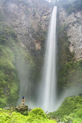 Tourist at 120m Sipisopiso Waterfall, Lake Toba (Danau Toba), North Sumatra, Indonesia, Southeast Asia, Asia