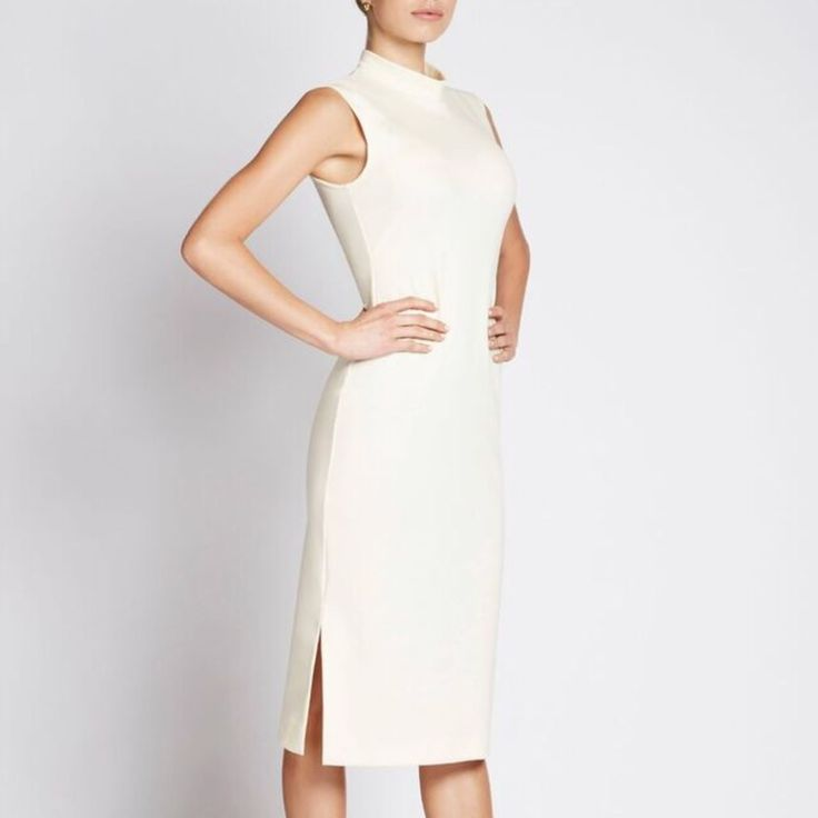 Ready to wear designer dresses for the office. For the modern, professional woman.