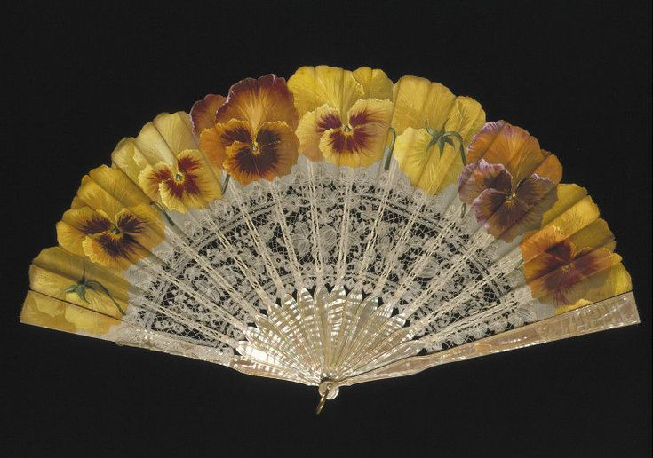 The leaf of this 1890-1900 fan carries the signature of Ronot-Tutin. He was a French fan painter who specialized in floral fan leaves.