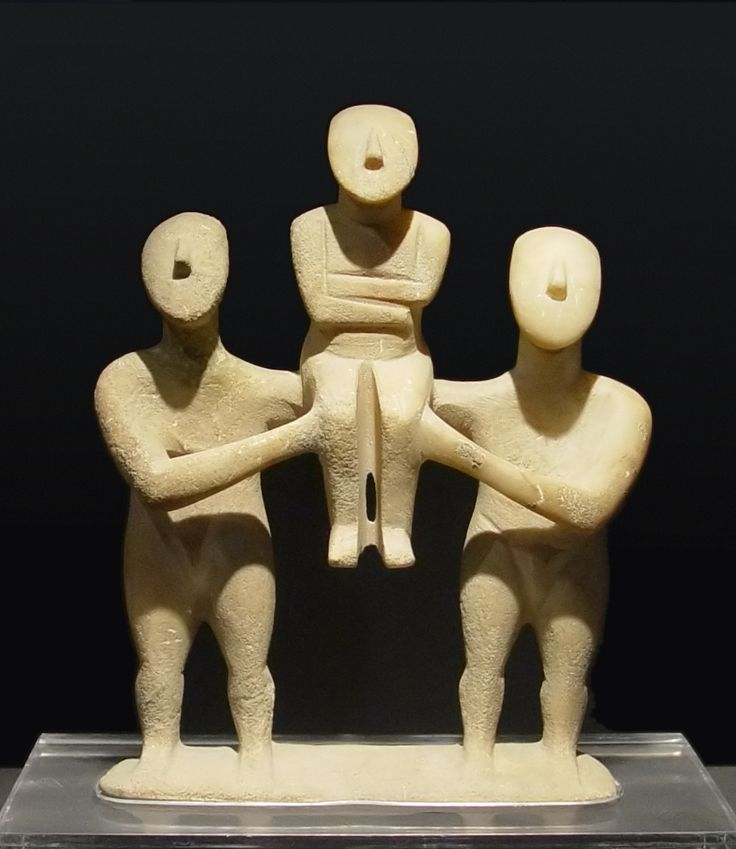 Cycladic three figurines group, marble, from the early cycladic II period. Currently located at the Badisches Landesmuseum, Karlsruhe, Germany.