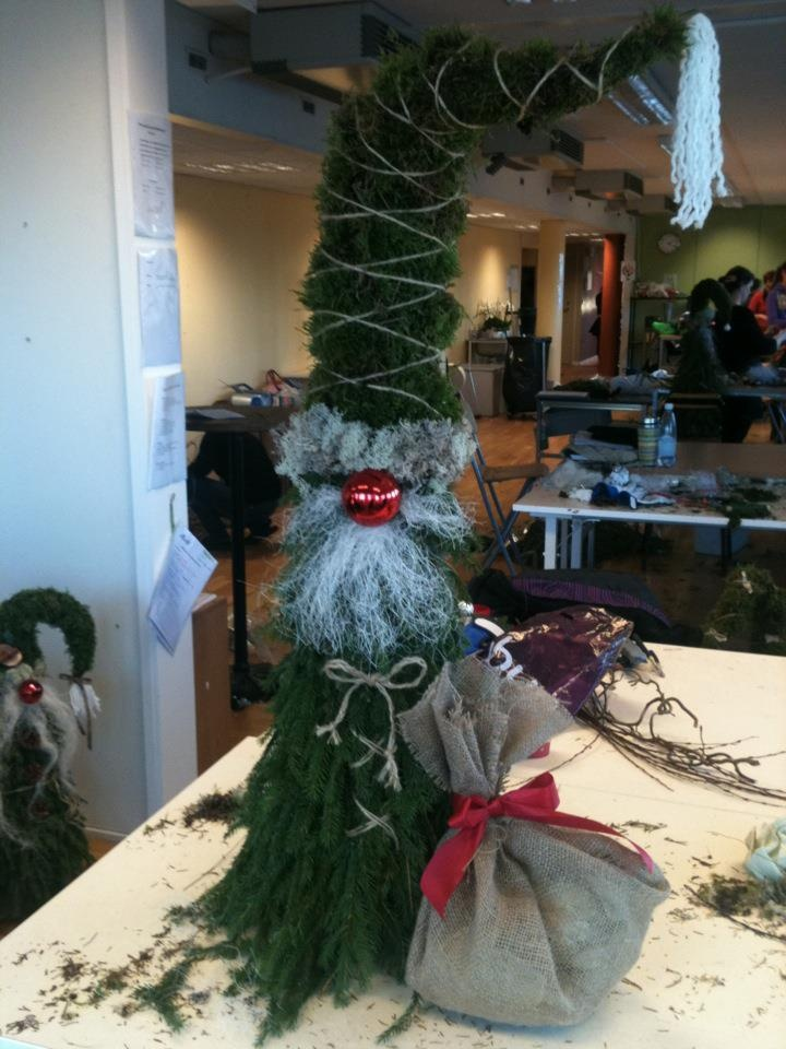 Santa Claus is coming to town. And he's made out of spruce and moss.
