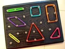 Geo Board - wood, nails, paint, hair ties. I bet I can make this idea work for a quiet book activity.