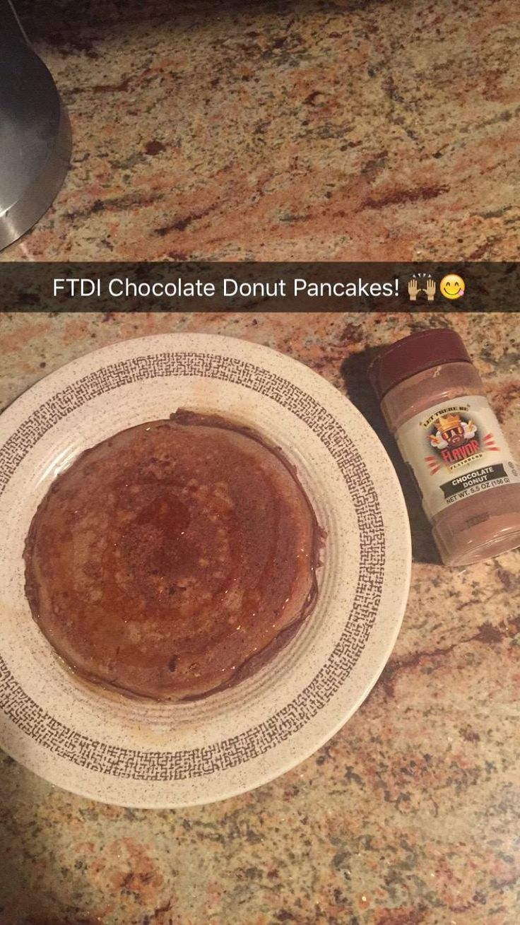 2oz steel cut oats or rolled oats (Blended in Nutri-bullet to make it into flour consistency) 4 pinches of baking powder 1 packet of Stevia 1 TB spoon of Flavor God Chocolate Donut Seasoning 1 scoop of Chocolate protein 1egg white (used real egg with out yolk) 1 teaspoon of vanilla extract Just added a little water to mix all ingredients together