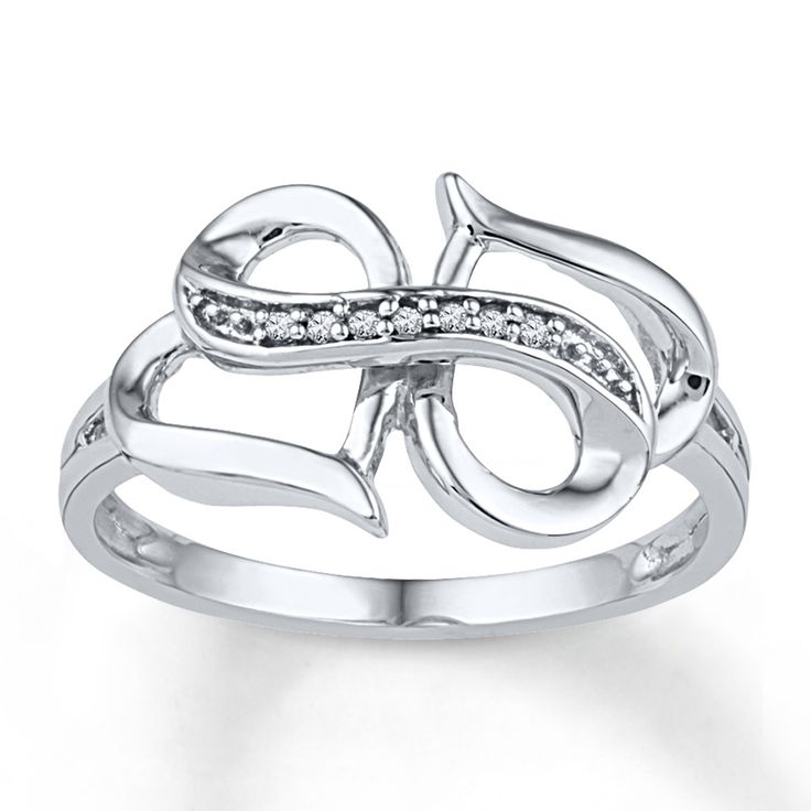 This unique ring for her combines hearts and the infinity symbol - two powerful ways to express your love. Accented with a line of sparkling round diamonds, the ring is fashioned in 10K white gold.