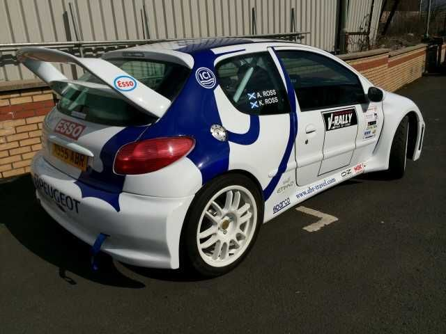 """A Peugeot 206 WRC Replica with full WRC body kit, full WRC replica paintwork, WRC Rally graphics,   Built on a Vic Lee Racing 206 Cup Car body shell,  Carbon roof vent,   Running on 1600 16 Valve engine from C2 VTS,   Pipercross Ram air filter,   Raceland manifold,    Removable front wings,   Sparco seat rails with new full wrap around Sparco seats, new belts,   Flocked dash,   Sparco steering wheel,   360 front discs, D2 8 Pot brakes,   New coil over suspension,   18"""" Ford Group A ..."""