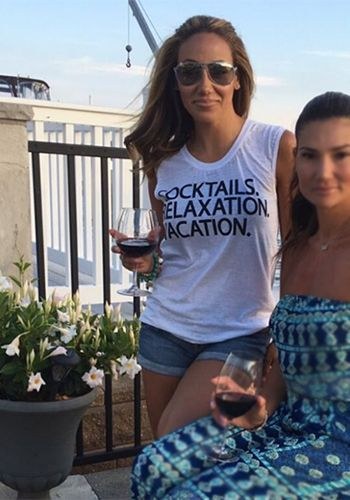 Melissa Gorga wearing a Chaser Cocktails Vacation Relaxation Tank https://api.shopstyle.com/action/apiVisitRetailer?id=536295944&pid=uid7729-3100527-84. #style #celebstyle #chaser #tanks