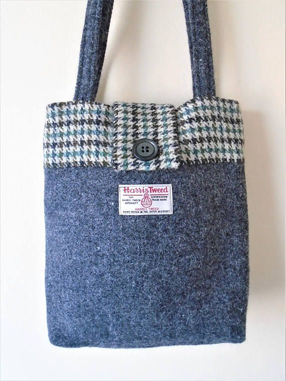 Harris Tweed bag made from a charcoal grey flecked tweed and dogs tooth check tweed in grey, cream and green shades. Fastens with a dark grey button. Harris Tweed label stitched on the front. T-junction base gives a nice shape and more room to fit things in this sturdy little bag. Lined with black cotton fabric. Measures 28 cm width x 32 cm length and 63 cm from top of handles to bottom of the bag. Shipping I aim to post purchases 1 or 2 working days after I have received payment. Deliver...