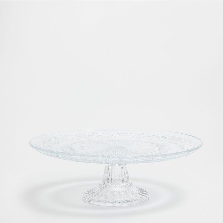 Raised design glass cake plate