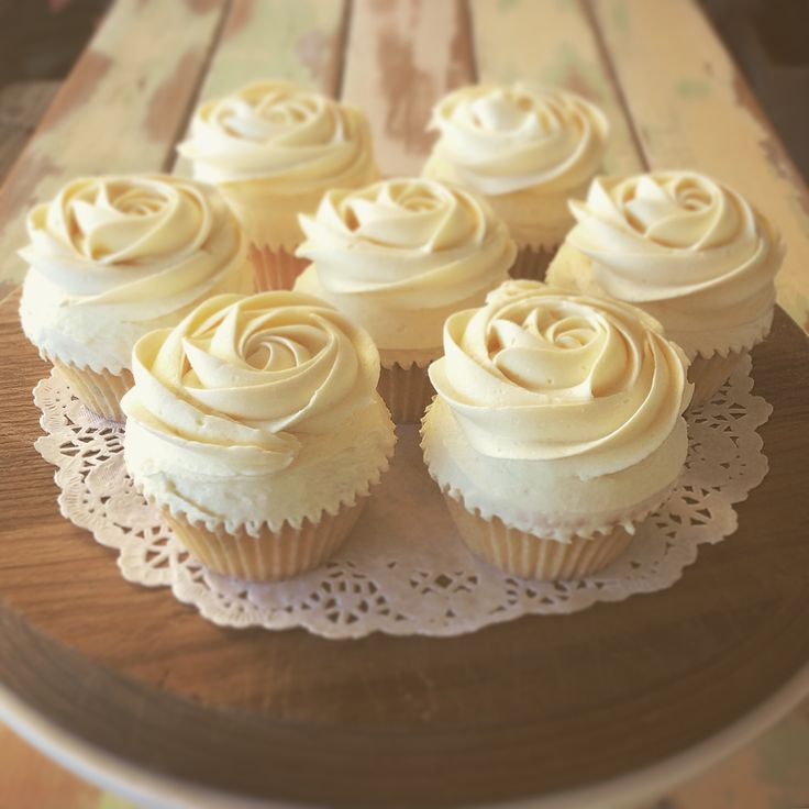 Passion fruit cupcake with white ganache rose.