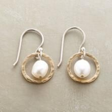 These lovely pearls in hoops earrings offer an air of timeless elegance.