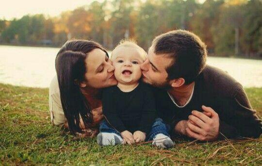 Mom, dad, baby shot