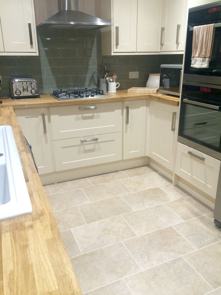 Burford Cream Kitchen from Howdens. Oak Worktops. Sage tiles with silver grout