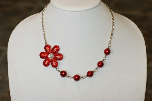 Here is a red flower necklace.  It's unique and asymetrical.  You could order earings before purchasing at :  franfoise@hotmail.com
