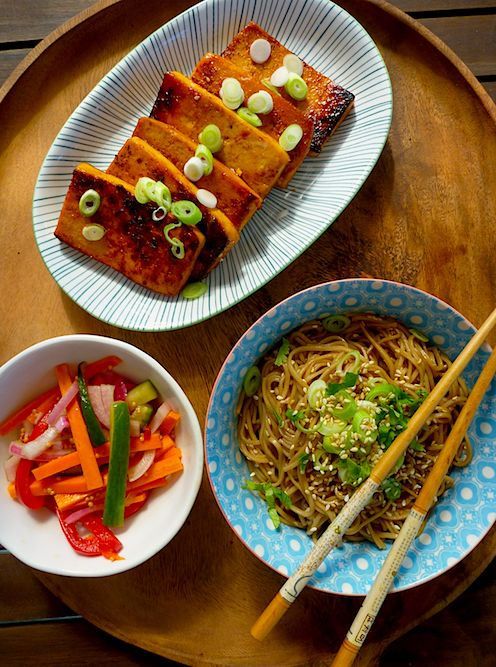 Sesame noodles with barbecued tofu steaks and quick carrot and cucumber pickle: hoisin sauce, mirin, soy sauce, brown sugar, ketchup, garlic, sugar, rice vinegar, sesame oil, whole wheat spaghetti, sesame seeds, scallions, carrot, cucumber, shallots, green chilis, white wine vinegar, turmeric, mustard seeds, olive oil