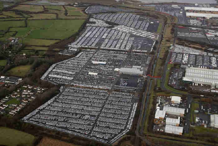a massive car park at Swindon, United Kingdom, with thousands upon thousands of unsold cars just sitting there