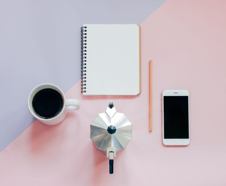 Creative flat lay photo of workspace desk with blank notebook, smartphone, pencil,  coffee and mokat pot with copy space background, minimal style