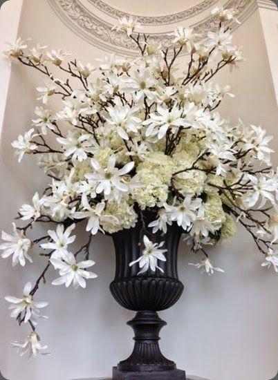Magnolia and hydrangeaflower arrangement by wild at heart #blackwhite #flowerarrangement #wedding