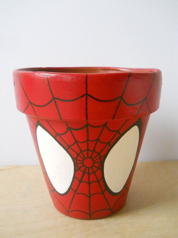 I should paint a flower pot like this and let my kids pick out the plants to go in it.