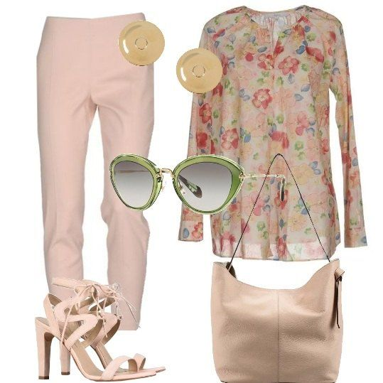 Un bellissimo paio di occhiali di Miu Miu, montatura a gatto, verdi con lenti sfumate, è abbinato ad un look chic: camicia di cotone, disegno floreale, pantaloni jacquard, di cotone elasticizzato, sandali di camoscio, con tacco geometrico e laccetti, shopper di pelle, orecchini a forma di bottone.