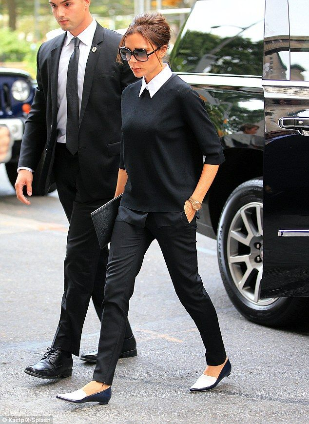 Turning heads: Victoria Beckham. The mother-of-four cut a typically polished figure in a chic jumper and tailored trousers