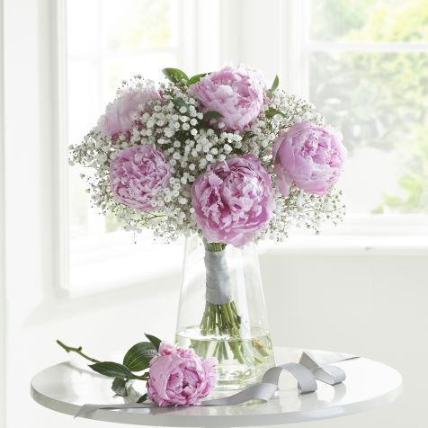 Gorgeous Pink Peonies and delicate white gypsophila have been carefully arranged and hand tied to produce an elegant round posy bouquet for a fresh summer feel.