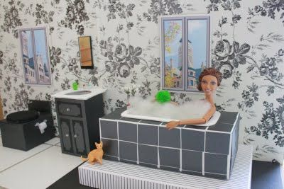 My daughter loves dollhouses - and we stumbled upon this mom's fantastic blog - myfroggystuff - she does recycled crafting and here's the post for their bathroom.  We don't buy dollhouse furniture anymore :)