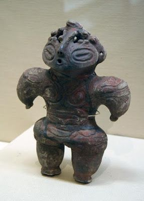 Dogu ( 土偶 ) are bug-eyed clay idols that represent women with these exaggerated features like big hips, thick legs, and nipples as fertility.