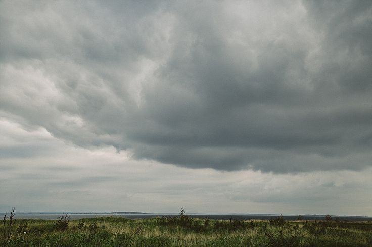 incredible dramatic panoramic views. lighthouse wedding in denmark. photo by camilla jorvad