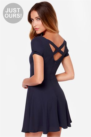 """LuLu*s Exclusive! How about dressing to the tune of the sweet and charming Pretty Little Ditty Navy Blue Dress?! This little looker has a modest short sleeve bodice with a scoop neckline and crisscrossing straps over a dipping, U-shaped cutout at back. Silky woven fabric composes a fitted bodice that flares into a full skirt, and small covered buttons that finish the pleated sleeve cuffs. Hidden back zipper/hook clasp. Fully lined in stretch knit. Model is 5'8"""" and is wearing a size X-small…"""