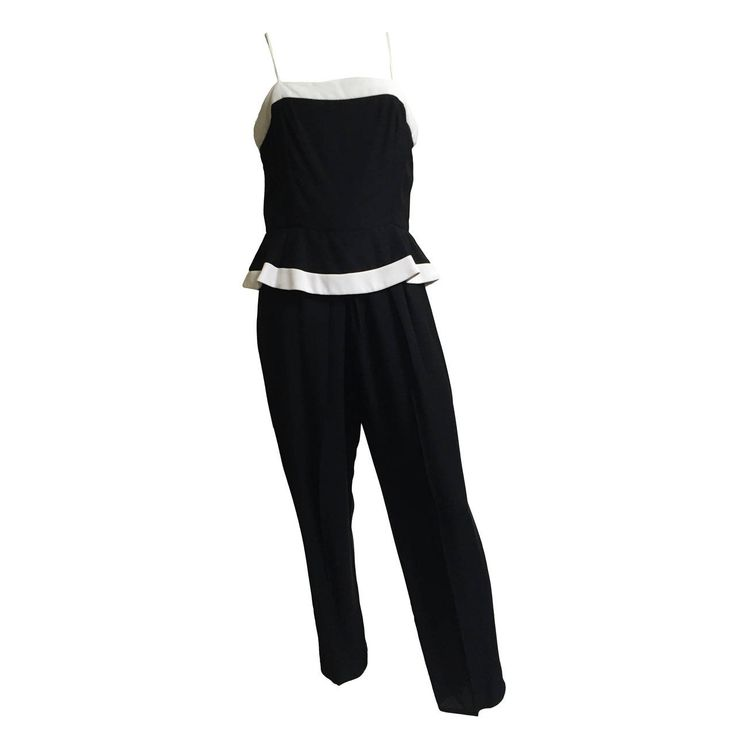 Raul Blanco for Saks Fifth Avenue 80s peplum jumpsuit size 6 / 8.   From a collection of rare vintage suits, outfits and ensembles at https://www.1stdibs.com/fashion/clothing/suits-outfits-ensembles/ @1stdibscom @SaksFifthAvenue #vintage #fashion #designer #forsale