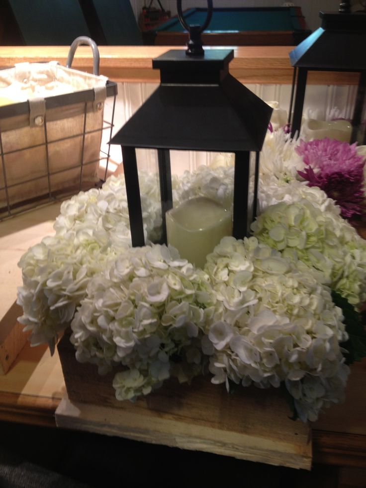 All white hydrangeas with lantern for head table