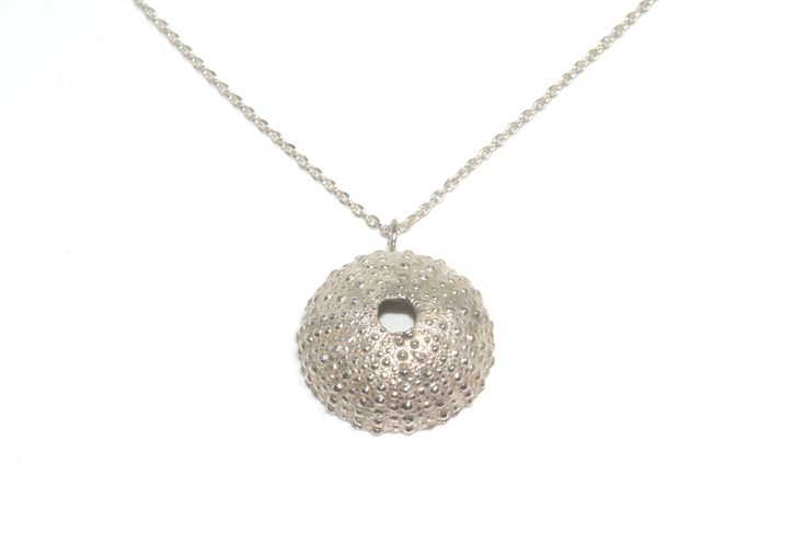 A detailed photograph of a Sea Urchin Handcrafted pendant. This beautiful necklace inspired by the sea treasures is made of silver 925. http://www.facebook.com/LillysPapillon