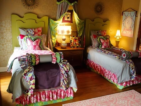 Create a room full of grace and elegance with this luxurious cotton and faux suede duvet cover in deep, rich tones.  Just when you thought it just could not get any cuter, fold down the duvet to reveal the green and pink floral charm on the back.  This makes any unmade bed look like pure cuteness.  Find it online at www.addisonswonderland.com!