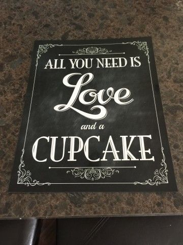 """8x 10 signs designed to look like chalkboard signs.  I framed them in 8x10 frames for my wedding.  I paid $5.00 a piece for the design on Etsy, and then $2.80 for the picture.  Sayings include: """"All you need is love and a cupcake"""" """"We knew that you would be here today if heaven wasn't so far away."""" ..."""