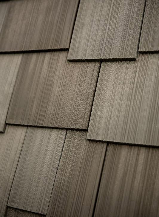 Roof material: Engineered Cedar Shake | Roof color: Weathered Brown | For more roofing ideas click through to our website.