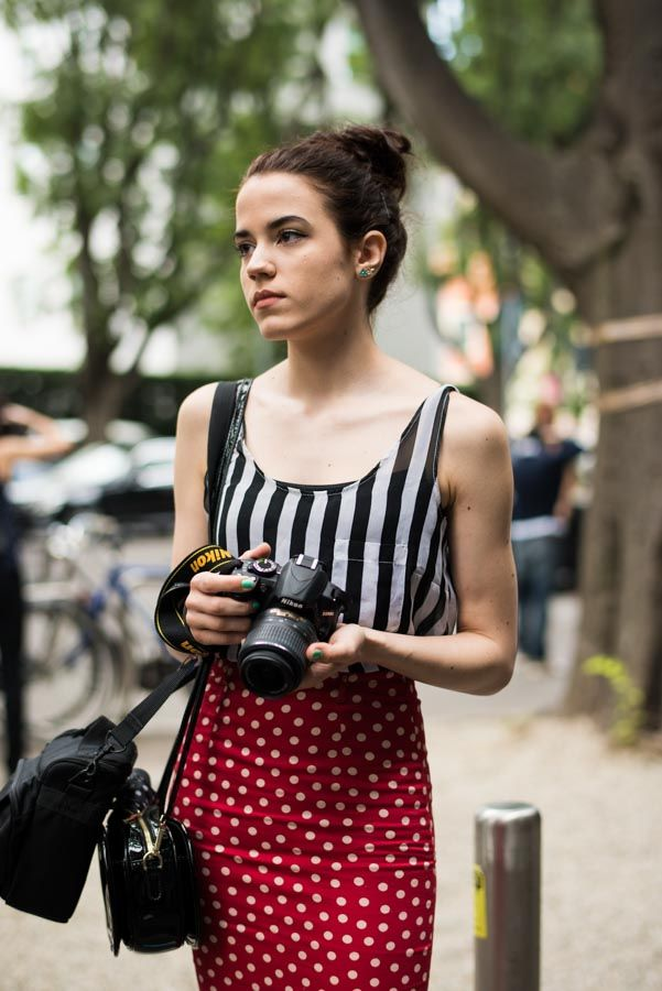 Street Style portraits by Ángel Robles. Fashion Photography from Milan Fashion Week. Photographer on the street mixing prints, stripes and dots, on her retro inspired outfit before Armani show, Milano.