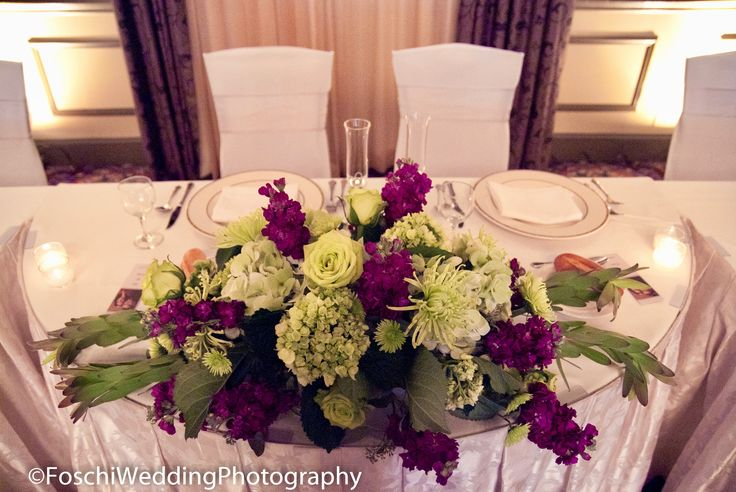 A decorative centerpiece in front of the bride and groom at Doubletree Hotel.