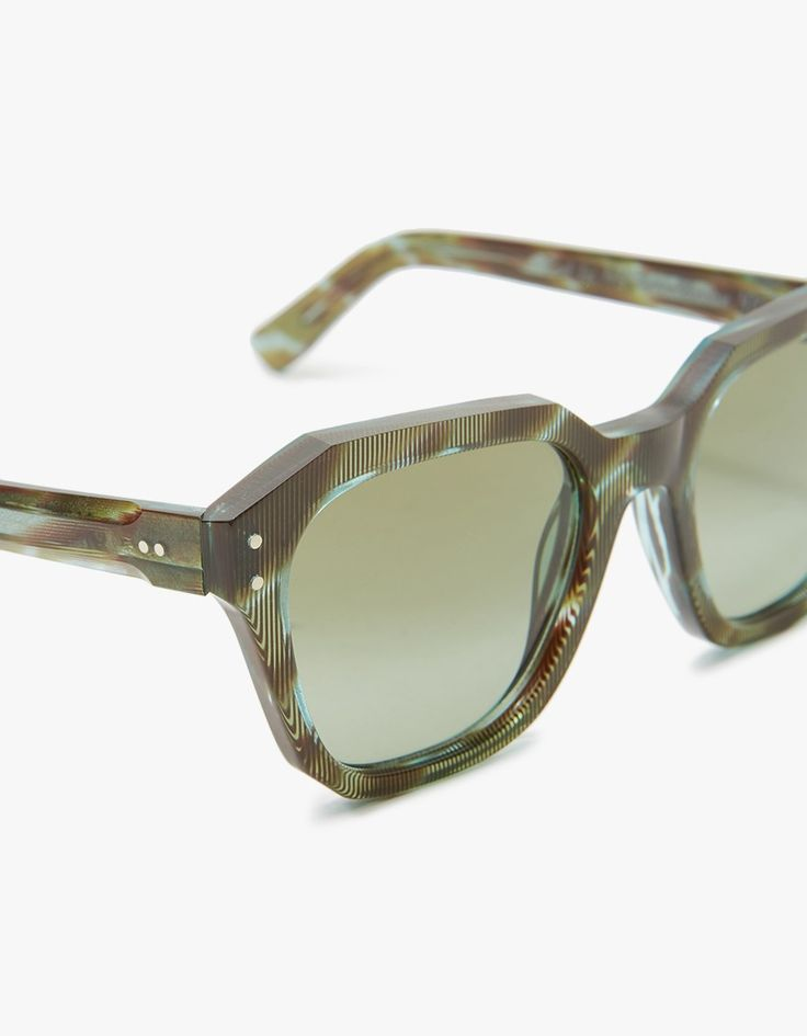 70s-inspired sunglasses from Ahlem. Mazzucchelli cellulose acetate frames with a geometric green pattern. Christian Dalloz Cridal 2 Base Lenses with interior anti-reflective coating. Threadlock hinge screws. Keyhole bridge. Seamless nose pads. Square shap