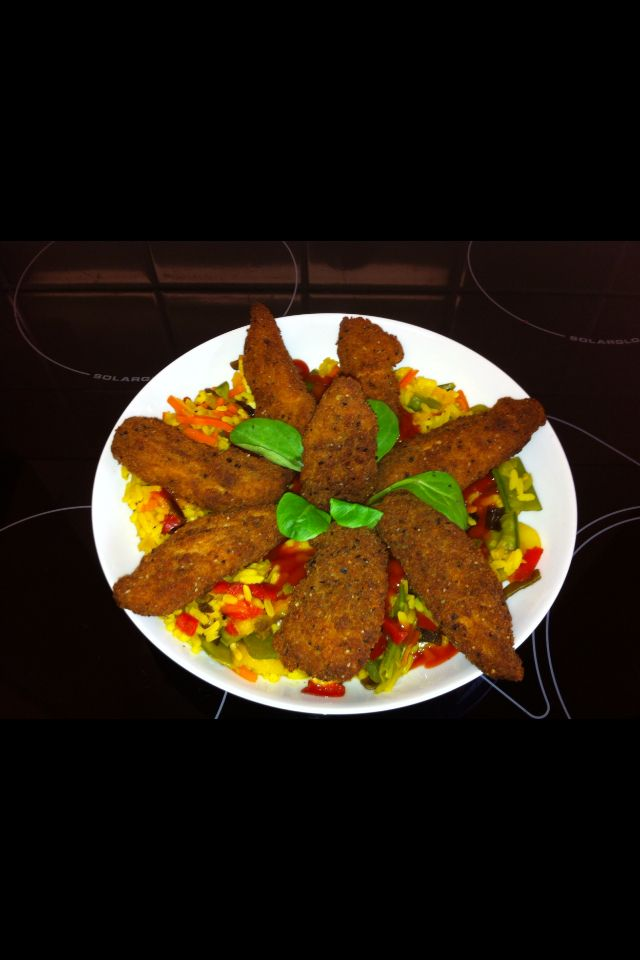 Southern fried chicken dish with rice & salad