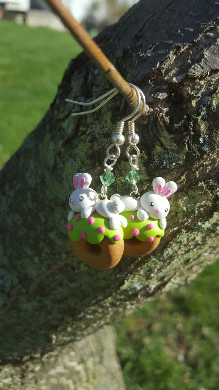 Springtime earrings! Bunnies on donuts with icing and sprinkles, and green Swarovski crystals.
