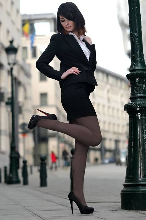 secretary posing in the street looking for potential
