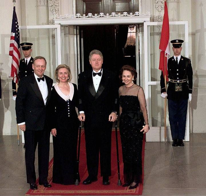 President Bill Clinton and Hillary Clinton pose with Canadian Prime Minister Jean Chretien and his wife Aline at the North Portico of the White House on April 8, 1997.