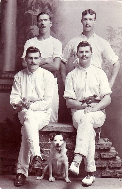 Four guys and a dog early 1900s