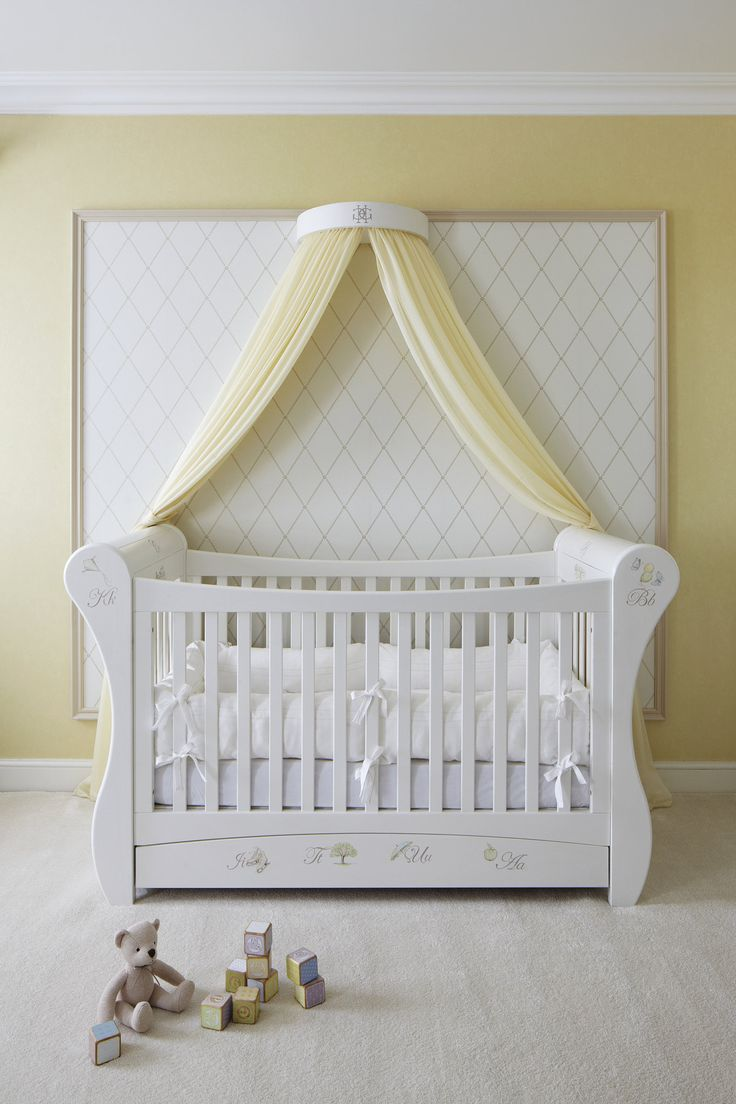 The crib, Dragon's own Scroll Top Cotbed ($1,984) is hand-painted in one of the store's new patterns designed just for the suite. It took five days to paint! The crib is topped off with a regal coronet (featuring the hotel's monogram) and sheer voile drapes. Source: The Grosvenor House