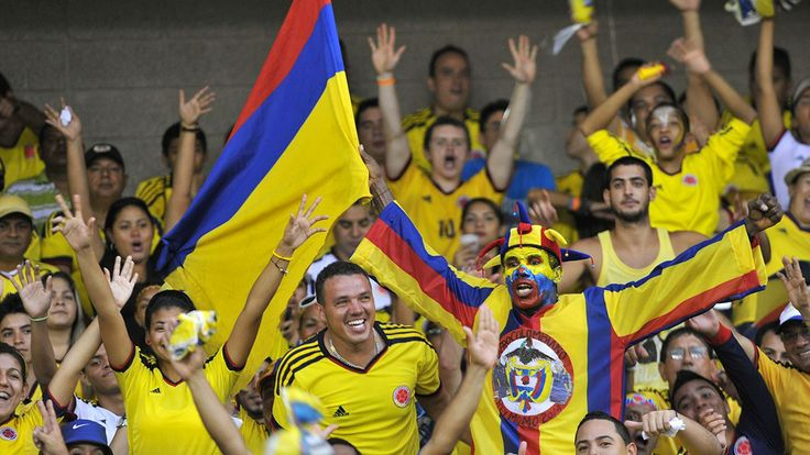 Supporters of Colombia cheer for their team before their FIFA World Cup Brazil 2014 South American qualifier football match against Peru at Metropolitan stadium in Barranquilla, Colombia, on June 11, 2013. AFP PHOTO/Luis ROBAYO