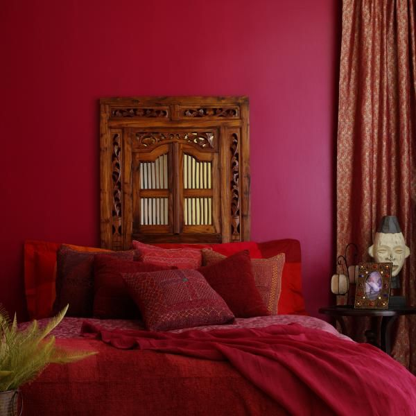 Exotic Red Bedroom - A deep red room will make a small bedroom exotic.