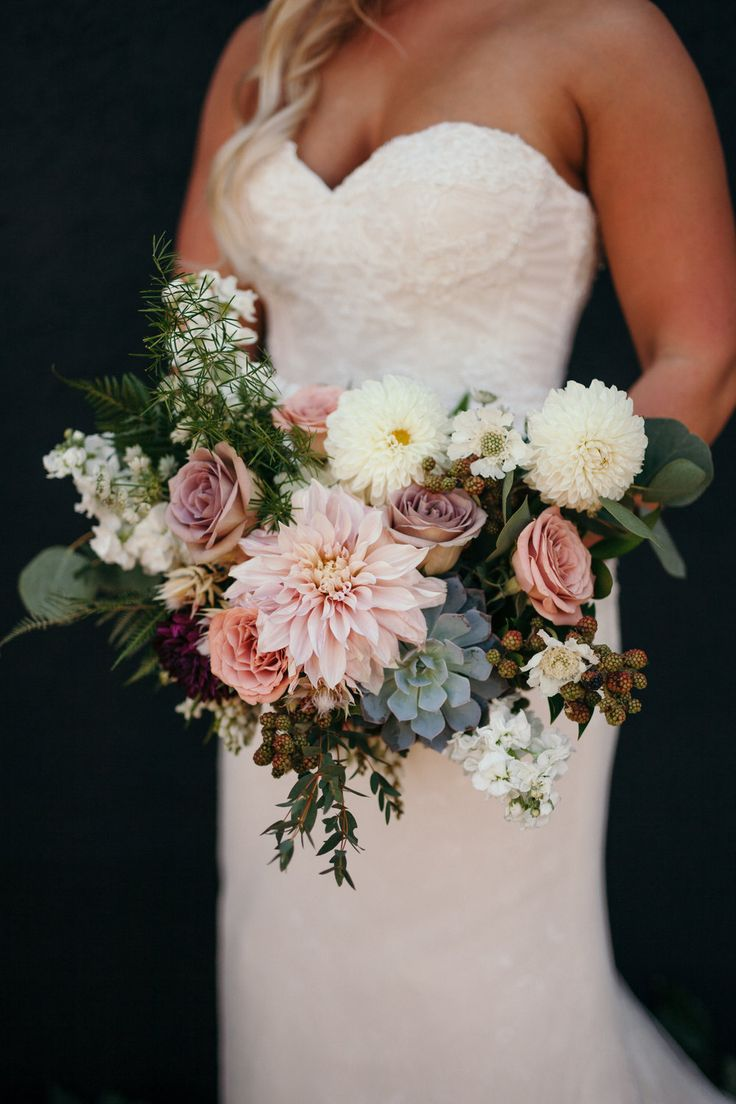 Flowers by Lace and Lilies, bridal bouquet with dusty colors and succulent. Dahlia, Garden Rose and Berries