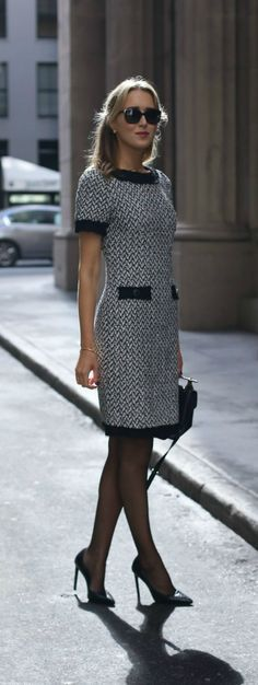 Black and white herringbone tweed sheath dress with black accents around sleeves and collar perfect for business formal client meetings in fall and winter! st. john knits, saint laurent, prada, m2malletier